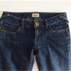 """[Free People] bootcut jeans FP Stretch Skinny Boot. Bootleg jean with 5 pocket styling. Low rise, skinny fit with stretch. Zip front with button closure and metal grommet detailing. 98% cotton, 2% spandex. In excellent condition with some wear in back hemlines as shown in the last photo. Size 26. Waist 14.5"""", inseam 32"""". Free People Jeans Boot Cut"""