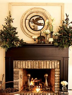 mini trees on fireplace