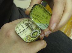 tin locket ring.... I like the tin decoupaged idea