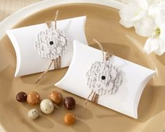 """http://www.mybomboniere.it/matrimonio/bomboniere-per-tema/shabby-chic/portaconfetti-vintage-love-letter.html """"Love Letter"""" Flowering Pillow Favor Box (Set of 24)  The loveliest garden that ever grew can grace your event tables and thank your guests for being there. Our pretty pillow favor box is versatile in classic black and white, accented with natural twine and a 3-D flower etched with words from Shakespeare's immortal sonnet, """"How Do I Love Thee?"""". Sweet romance!"""