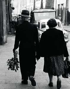Elderly Polish couple walking hand in hand by Paul Schultzer