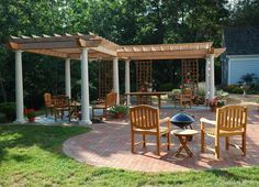 A nice example of an L shaped pergola in clear Cedar with tapered Tuscan columns