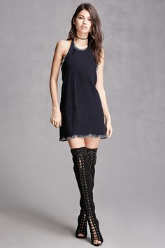 A denim mini dress featuring a raw cut trim, self-tie halter neck, open back, snap-button sides, and a flared silhouette. This is an independent brand and not a Forever 21 branded item.
