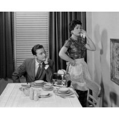 Woman ignoring husband at dining room table Canvas Art - (24 x 36)
