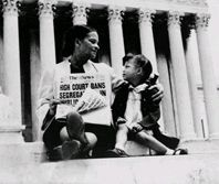 Nettie Hunt, sitting on the steps of the U.S. Supreme Court building, explains the significance of the court's May 17, 1954, desegregation ruling to her daughter, Nikie. (UPI Tele/Files, New York World-Telegram and the Sun Newspaper Collection, Prints and Photographs Division)
