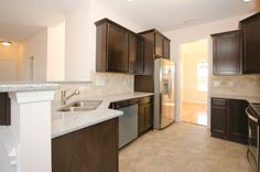 The Biltmore kitchen with granite counter tops. Built by Mckee Homes.