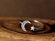 • Simple but gorgeous crescent with a star shape ring, nature theme item Tiny rhinestones are on the crescent