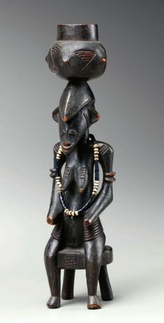 Africa | Seated figure from the Senufo people | Wood, glass beads | Prior to 1960   ||||  Source; http://issuu.com/artsolution/docs/senufo