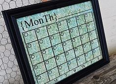 Vinyl decal placed on back of glass in repurposed frame creates a stylish dry erase calendar. -Can't wait to make this for my office