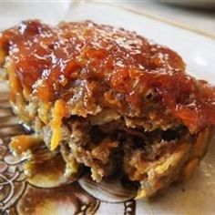 Shredded Cheddar cheese is baked right into this easy meat loaf. Brown sugar, ketchup, and a touch of mustard make a delicious, sweet and tangy crust.