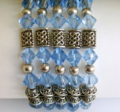 """""""Five identical beaded strands of stretchy cord combine to make this stunning silver and sapphire crystal bracelet.  Make it in less than an hour and wear it everywhere."""""""