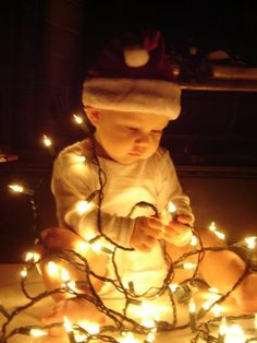 Babies first Christmas photo! Adorable with the lights!    #baby