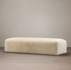 """FULHAM SHEARLING COFFEE OTTOMAN $3130 An oversized silhouette clad in sumptuous shearling with deep padding offers exceptional comfort and relaxed style.   Oversized for sink-in comfort and the natural warmth of sheepskin Hand built with a kiln-dried hardwood frame Triangle block frame For superior durability, thick, resilient foam seat is supported by pocket coil and 8-way hand-tied springs  DIMENSIONS 52""""W x 32""""D x 18""""H 79""""W x 32""""D x 18""""H"""