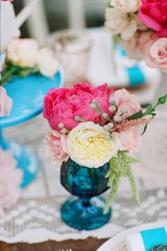 Pink and white flowers in a royal blue Vase