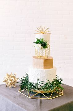 Modern touches like gray marble cake + bits of subtle greenery woven in will make for a magical wedding day.