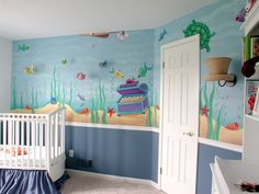 Underwater mural with friendly fish,  treasure chest, coral, and other sea creatures.
