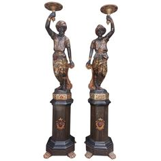 Pair of Italian Polychromed Blackamores on Octagonal Plinths, circa 1800 | From a unique collection of antique and modern statues at https://www.1stdibs.com/furniture/building-garden/statues/