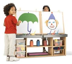 Keeping kids busy can be hard, but once you put art supplies in their hand masterpieces are created on a daily basis. Affordable and built to last the art station will be a huge hit in your classroom. #kids #play #draw #arts #crafts #learn #preschool #toddler #parents #moms #dads #friends #school