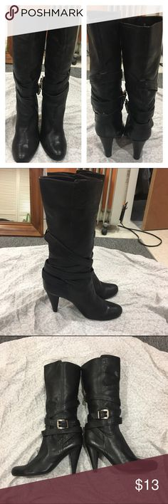 """Black high heel boots Tall black high heel boots. Has straps around them with silver buckles on the outside of both boots. Heel is about 4"""" tall. The right boot has some wear on the heel and top outside of the boot, and both have a little wear on the toes. Not very noticeable. Pictured in fourth picture. Other than the they're in good condition. Feel free to make me a reasonable offer 💕 BCBGirls Shoes Heeled Boots"""