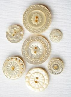 """Group of carved and drilled sew through mother of pearl buttons from various periods of time. Mother of pearl is known as """"the shell of sincerity"""". It signifies faith, charity and innocence. Button Cards, Button Button, Vintage Accessoires, Couture Vintage, Passementerie, Sewing Notions, Sewing Box, Mother Of Pearl Buttons, Haberdashery"""