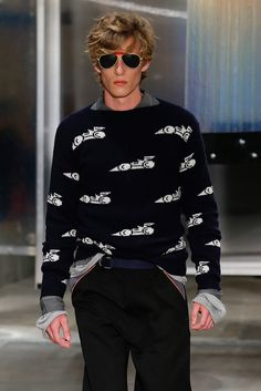 Prada - Arguably one of the season's most unlikely motifs? Racing, cars, and all shiny things that go vroom in the night.