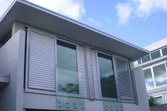 Sliding window shutters for western elevation