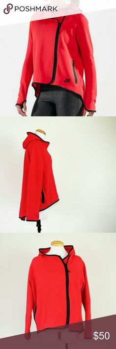 Nike Tech Fleece Cape in Action Red/Black Nike Tech Fleece Cape in gently used condition. Features a soft cotton blend fabric, scuba hood and drop-tail hem to help keep you warm. It also has an asymmetrical front zip, elastic cuffs with thumb holes, and side zip pockets for storage. Perfect for those cool nights and early mornings!   Please let me know if you have any questions or need more pictures. I will consider all reasonable offers, but no trades, please. Nike Tops Sweatshirts…