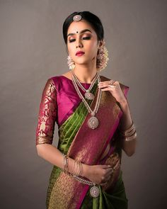 South Indian bride. Gold Indian bridal jewelry.Temple jewelry. Jhumkis.Green and pink silk kanchipuram sari.Braid with fresh jasmine flowers. Tamil bride. Telugu bride. Kannada bride. Hindu bride. Malayalee bride.Kerala bride.South Indian wedding. Pinterest: @deepa8