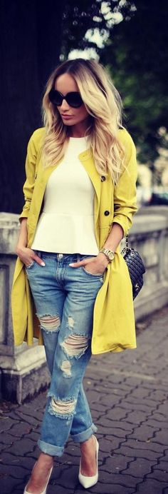 To create an outfit for lunch with friends at the weekend try teaming a mustard trench with blue destroyed boyfriend jeans. Take a classic approach with the footwear and rock a pair of white leather pumps. Shop this look for $240: http://lookastic.com/women/looks/sunglasses-peplum-top-trenchcoat-watch-crossbody-bag-boyfriend-jeans-pumps/4842 — Black Sunglasses — White Peplum Top — Mustard Trenchcoat — Gold Watch — Black Quilted Leather Crossbody Bag — Blue Ripped Boyfriend Jeans — ...