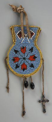 American Indian Art:Beadwork and Quillwork, AN EASTERN SIOUX PICTORIAL BEADED HIDE POUCH. c. 1900...