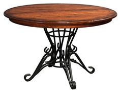 Forged Pedestal Round Dining Room Table from DutchCrafters Amish Furniture. Iron forged scrolling single pedestal base supports a solid wood round top. Available in three widths with the option to purchase additional extensions. #diningtablewithironbase