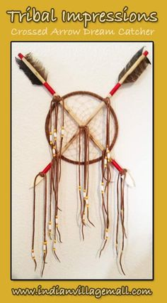 The Peace Dream Catcher  Handmade Large Dream Catcher With Crossed Arrows    A mystical dream catcher that holds arrows handmade from suede, turkey feather, beads, suede, leather and bones. Arrowheads are hand carved. Crossed Arrows is the a Native American Symbol for peace. Very nice bead work and fringing. Cross arrows means friendship. Measures 6.3 inches. http://www.indianvillagemall.com/dreamcatchers/index.html