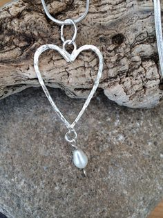 A personal favourite from my Etsy shop https://www.etsy.com/uk/listing/192009728/beautiful-heart-drop-solid-silver-and