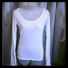 NWT Aeropostale White shirt with lacey back. Aeropostale Casual white long sleeved shirt with sexy see through lacey back and lace detail on sleeves. Scoop neck.  New with the tags attached.  Size small Aeropostale Tops Tees - Long Sleeve