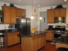 pictures of cambria countertops with honey oak cabinets | your help, Our kitchen with tan brown granite countertop and honey oak ...