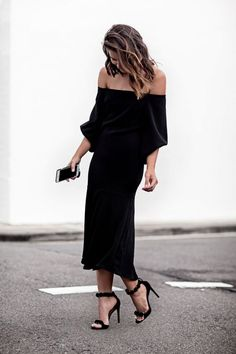 Black off the shoulder dress.