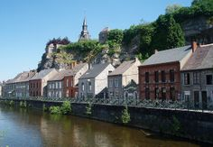 Riverside at Couvin, province of Namur, Belgium. With a total area of 207 km² Couvin has a population density of only 65 inhabitants per km².