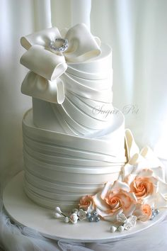 Bows and Drapes wedding cake - For all your cake decorating supplies, please visit craftcompany.co.uk