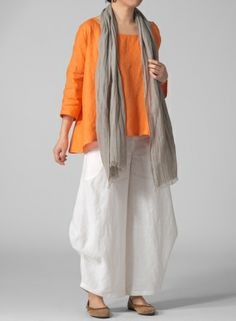 This top is comfortable yet trendy with its loose fit details! Pair with wide leg pants for a fashionable day outfit and to dress up for a night look. www.vividlinen.com