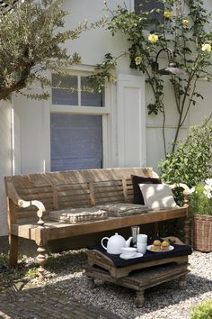 I love these low tables.  Maybe mix some weathered grey in with all the brown. gravel courtyard