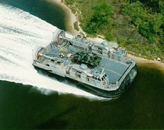 The US military calls them Landing Craft, Air Cushion (LCAC). They're high-speed, fully amphibious hovercraft capable of carrying a 60-ton payload (75 tons in overload) over water and land at speeds in excess of 40 knots and a nominal range of up to 200 nautical miles. Carrying equipment, troops, and/or supplies, the LCAC launches from inside the well deck of an amphibious warship, then travels the waves at high speed, runs right through the surf zone near the beach, and stops at a suitable…