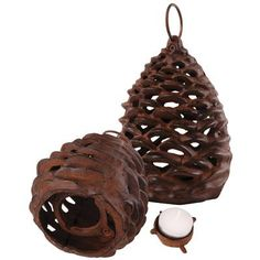 Google Image Result for http://www.thomasandlucia.com/images/_lib/cast-iron-fir-cone-tealight-holder-3020088-0-1352936877000.jpg