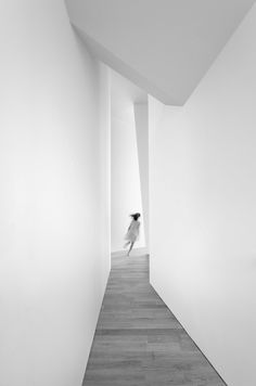 A figure spied down a long corridor
