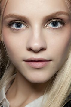 Ginta Lapina for Anna Sui.  Makeup by Pat McGrath.