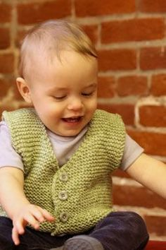 """Elit Baby Muare Baby Vest Free Knitting Pattern Download. Skill Level: Easy Easy to knit garter stitch baby vest. To Fit Size: 6-9 months (12-18 months, 2-3 yrs, 4 yrs, 6 yrs). Approximate Finished Chest Circumference: 20½, (22 ½, 24, 26, 28)"""". Materials: Elit Baby Muare: 1, (1, 2, 2, 2)—100g balls, color 1702 Green Gauge: 18 sts= 4"""" in garter stitch on US Size 8 (5mm) knitting needle after blocking. Needles/Notions: US Size 8 (5mm) 24"""" circular needle, 3, (4, 4, 4, 4) buttons, we u..."""