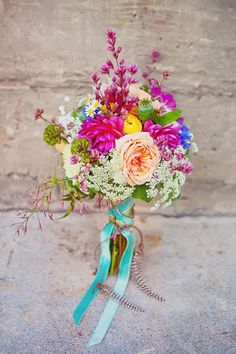 Love the trailing ribbon and mix of colours. hippie San Francisco wedding ideas