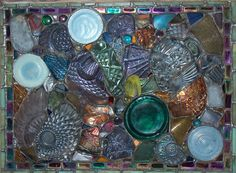 This is made from glass shards and as-found broken glass dishes, cups, bowls and bottles that I find in thrift stores, yard sales, and scavenge from old desert dumps. I love the idea of making something beautiful out of what other people throw away or discard.