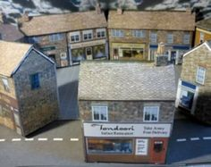 Want FREE paper and card building kits for your model railway, get them here. Includes Printable shops, houses, churches, stations & engine sheds for OO & N scales. N Scale Model Trains, Model Train Layouts, Scale Models, N Scale Buildings, Free Paper Models, Model Building Kits, Model House Kits, Paper Houses, Model Homes