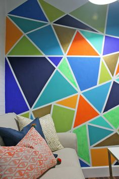 This room uses triangles to create the design of the wall and can be seen in the accessories.
