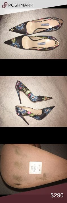 Super Sexy Brand New Prada pumps! Size 9 Authentic Gently worn 4.5 inches high. Pointy toe. The base color is black with multi color flowers. No dust bag no box. I have shoe racks in my home, which is where these girls live! Prada Shoes Heels
